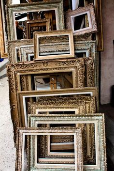 frames at flea market. An inexpensive way to make really cool wall art! The eclectic mix of colors/stains looks great, but you can also spray paint them all one color for a more uniform look!