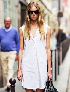 Thanks for the inspiration, Ieva Laguna! After spotting model Ieva Laguna's downtown cool street style take on the sleeveless white shirtdress, it's now at the top of our must-have list. There's nothing like a white dress for summer— the styling possibilities are endless!  Scroll through to see the model-off-duty inspiration and how to get the look... via @WhoWhatWear