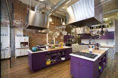combination of wood, brick walls and vivid colors - purple of cabinets is similar to passion plum of benjamin moore