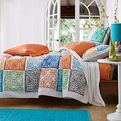 Echo Quilt and Sham from The Company Store to go with Gray Upholstered Headboard.  Colorful but too feminine.