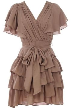 Cappuccino Cascade Dress: Features a wrapped surplice bodice framed by layered flutter sleeves, beautiful paneling to the waist and upper back, adjustable ribbon belt, and an extravagant ruffled hem to finish.