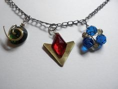 Legend of Zelda necklace, he three spiritual stones, the Kokiri Emerald, Goron Ruby, and Zora's Sapphire
