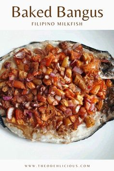 Baked Bangus is a Filipino baked milkfish recipe that is topped with onions, tomatoes, ginger, and soy sauce. #bakedbagus #bangus #milkfishrecipe