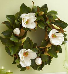 Magnolia wreath, my mom makes these every year from our magnolia trees and puts a gorgeous bow in them!
