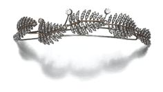 DIAMOND HAIR ORNAMENT, 19TH CENTURY. Composed of a series of stylised ferns set with circular-cut and rose diamonds, to a frame and later wire comb. (Sotheby's)