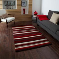 Add ultra modern style to any living space with this Think Rugs Hong Kong 2022 Red Striped Rug in contrasting hues of red, brown, cream and beige. This hand-tufted rug is constructed from acrylic material for soft, strong durability. Stripes Design, Red Stripes, Big Rugs, Striped Rug, Hand Tufted Rugs, Modern Rugs, Modern Living, Brown Beige, Rug Making