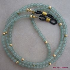 Green aventurine and gold eyeglass chain for reading glasses.