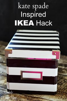 Use inexpensive boxes from Ikea to create some boxes inspired by the Kate Spade Black & White Striped Nesting Boxes.