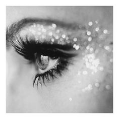 Here is another image on the emphasis of the eyes and eye makeup. The sparkles demonstrate texture and contrast. I can see Miranda and the fairies with sparkly eyes. It creates a magical feel.