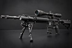 marksman's AR-15 carbine with bi-pod and more powerful scope for improved long range accuracy
