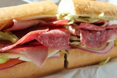 Super Sandwich: Italian Grinder   Nothing beats a good Italian grinder. Call it a hoagie, a hero or even a sub. There's no hard fast rule as to what goes into an Italian grinder. What it needs is a nice bread, a variety of meats, cheese, vegetables, and olive oil and vinegar. Eat it cold or toast it up. Either way, you've got one helluva good sandwich. - Foodista.com #frenchbread #lettuce #tomato