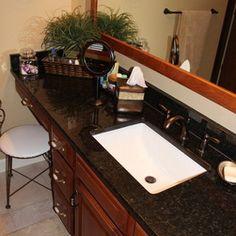 Bathroom Faucets For Granite Countertops master bathroom with dark granite countertop rubbed bronze faucet