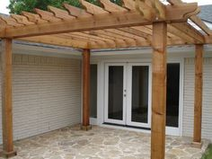 a fun and functional cedar pergola that defines the space and adds a little shade from the sun; can easily increase the amount of shade by adding canvas right over the top of the pergola, or weaving it in between the cedar slats for a unique effect