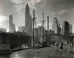 Fulton Street Dock, Manhattan skyline, Manhattan. by New York Public Library, via Flickr