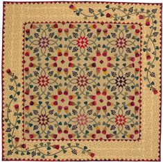 Berries and Buds: Patchwork stars and lavish machine appliqué adorn designer Kim Diehl's quilt, destined to become an heirloom.