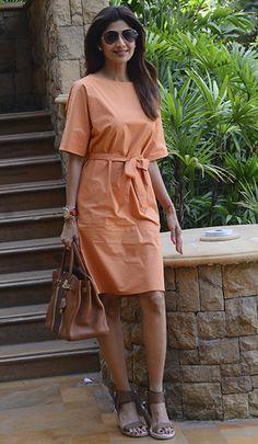 Shilpa Shetty in an Inside Jigsaw dress, Dolce Vita sandals, & Hermes bag