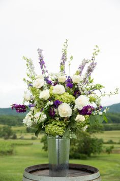 Beautiful white and purple flowers: http://www.stylemepretty.com/virginia-weddings/charlottesville/2014/04/03/deployed-groom-comes-home-to-beautiful-farm-wedding/ | Photography: Aaron Watson - http://www.aaronwatsonphoto.com/