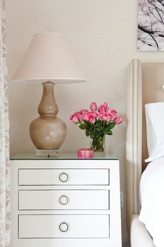 Flowers on bedside table.