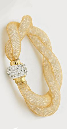 Stunning Crystal Filled Bracelet Wrapped in Golden Mesh, exquisite with a Pave Crystal Closure.