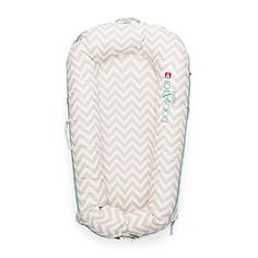 DockATot Deluxe+ Dock (Silver Lining) - The All in One Baby Lounger, Portable Crib and Bassinet - Perfect for Co Sleeping - Breathable & Hypoallergenic - Suitable from 0-8 months  REINVENTS THE WOMB: DockATot has been designed to offer a safe, snug and soothing environment for babies. We like to think it's the next best thing to the womb. Babies can rest, play and lounge without the restrictions of buckles or the distraction of bells and whistles and also allows parents to safely co sl...
