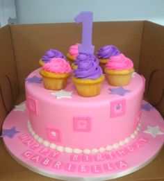 Pink, purple themed 1st birthday cake