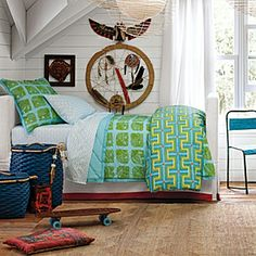 """The Frankie Duvet is going to look great in the twins' room. Their walls are painted in a pale Donald Kaufman paint & three of the walls have windows so it's abundant with light. This geometric print with tangerine, turquoise & lime is the perfect slash of bold colors to make the bed look fresh & """"big boy"""" without being too mature."""