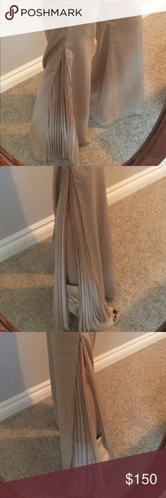 Gorgeous silk St. John evening pants These gorgeous St. John evening silk pants in a beach shimmer color have a beautiful slip up to the knee on each side of the leg with a flowing ruffled effect. Pictures cannot begin to do them justice. St. John Evening Pants Trousers