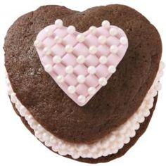 A lovely Valentine's dessert trimmed with fondant and pink Sugar Pearls, its base begins with the Heart-Shaped Whoopie Pie Pan.