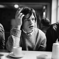 Mick Jagger with coffee and cigarette