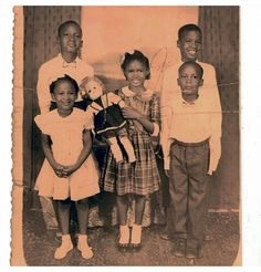 Grace Jones (with doll) and siblings as a child in Spanish Town.