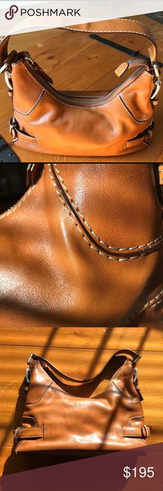 Michael Kors leather handbag Beautiful Michael Kors leather handbag in a gorgeous brown color with contrast stitching detailing and silver tone buckle accents. Dust bag included. In excellent condition. MICHAEL Michael Kors Bags Shoulder Bags
