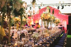 Chandeliers , candelabras, navy blue napkin orchids, hydrangea roses, every single detail for this stunning luxury wedding at floras farm ...Flora Farm Whimsical wedding planned by Allure Events | Floral Design by Lola del Campo Florenta