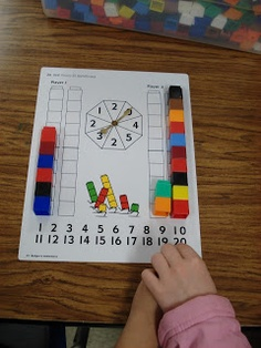 """Counting/adding game with Unifix cubes. """"Race you to 20"""" could easily be adapted to a lower number for younger children or made more difficult by adding a subtraction element."""