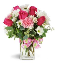 They'll thank their lucky stars when they receive this delightful arrangement! Hot pink roses, soft pink carnations, and more - a stylish mix perfect for any modern girl!