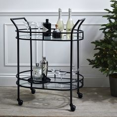 Our luxe, glass-topped drinks trolley is the show-stopping piece to add glamour to any party. This contemporary black-steel drinks cart has four wheels that make it easy to move around to serve guests, giving you top-host status. The cart has two tempe The White Company, Drinks Trolley, Bar Trolley, Drink Cart, Sweet Home, New Homes, Contemporary, Modern, Interior Design