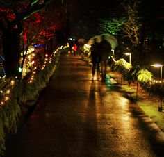 A couple walks along the lighted paths of Victoria B.C.'s beautiful Butchart's Gardens. The attraction decorates its grounds for the Christmas season.
