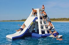 Wet & wild: Who needs to go to a water park when you can set up a giant inflatable slide in your private marina for paltry $8,000