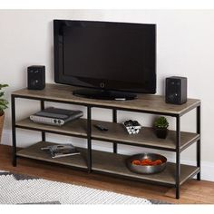 diy tv stand The Contemporary Style Simple Living Piazza Entertainment Stand is the perfect accessory for your home. Featuring a black metal frame with a reclaimed look finish top and shelves for all of your media and accessories. Metal Tv Stand, Diy Tv Stand, Bedroom Tv Stand, Tv In Bedroom, Muebles Rack Tv, Contemporary Tv Stands, Contemporary Style, Swivel Tv Stand, Cool Tv Stands