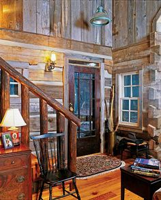 Not one of the interior doors in Alan and Susan Rogers' fits a standard profile. All are antiques, just as the stair railings and banisters are fashioned from old poles that were originally used to dry tobacco in sheds throughout the South. In the dormers above the first floor, weathered barnboard sheathes the interior walls.
