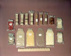 Food kit used by Mercury astronauts. Some is dehydrated and needs water, other packets are ready to eat. Size is measured relative to a ruler. Included are packets of mushroom soup, orange-grapefruit juice, cocoa beverage, pineapple juice, chicken with gravy, pears, strawberries, beef and vegetables and other assorted food containers. Credit: NASA