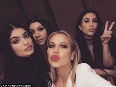 'Sister Sunday': Kim posed for a selfie with (L-R) Kylie, Kourtney and Khloe inside the re...