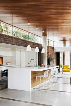 ...LOVE the window at the top and look at that floor...nice idea with the stones to break the concrete floor! #kitcheninteriordesigntraditional