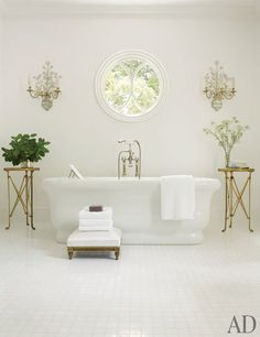 S. Kalser - The master bath's tub and fittings are by Waterworks; the bronze-doré tables, found at a French flea market, once graced the Four Seasons Hotel George V Paris.
