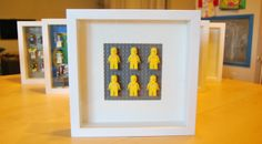 This would look AMAZING in the kids rooms.   RIBBA-Lego-Minifig-Display-2x3-Yellow