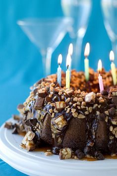 Just like its name suggests, this chocolate cake—coated in a caramel-toffee topping—will fulfill all your chocolate cravings.  Get the recipe at Culinary Covers.   - CountryLiving.com
