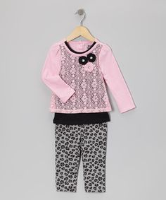 Sweeties will love sporting this ready-to-go getup! With lively leopard leggings and a lacy two-in-one top, it offers dainty darlings a complete head-to-toe look that's teeming with charm.
