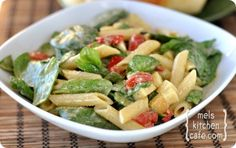 Whole Foods Smoked Mozzarella, Spinach and Pasta Salad. So good - one of my favorite recipes...much cheaper to make yourself. This is great to bring to a pot luck or BBQ! -Stephanie