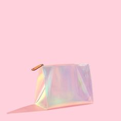 Large Pyramid Cosmetic | Holographic PVC | A minimal cosmetic case is anything but boring in textured,...
