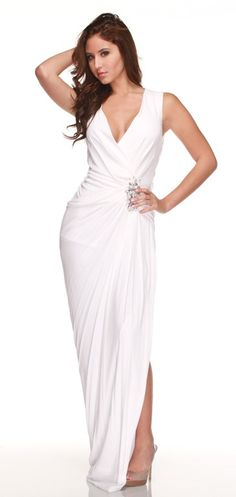 This elegant white dress by Robert Rodriquez is perfect for a second wedding dress or used for a beach wedding. This piece features a deep V neckline, a cluster id embellishments on the left side towards the hip, a side- hidden zip, and a slit up the left side of the dress. This simply yet ravishing dress will gave people breathless.    Color: White  Fabric: 100% rayon   $70.00