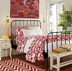 not so sure about the red, but I love the black metal bed and the white furniture!